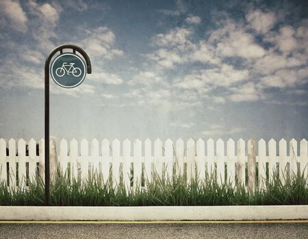vintage style of bicycle sign and white fence and blue sky photo