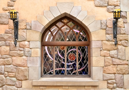 Arched window in a stone wall photo