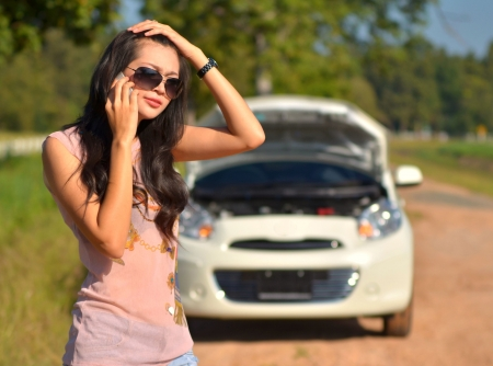 A woman calls for assistance  after her car broke down