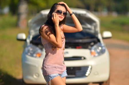 A woman calls for assistance  after her car broke down  Stock Photo - 16227833
