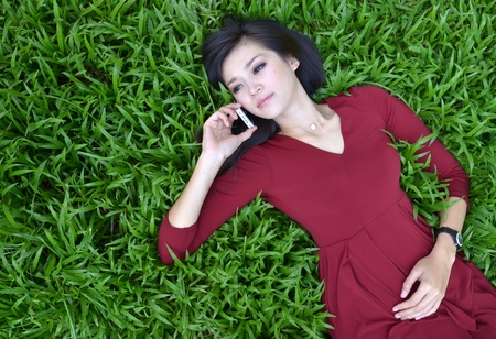 pretty woman making a phone call in the garden Stock Photo - 16141526