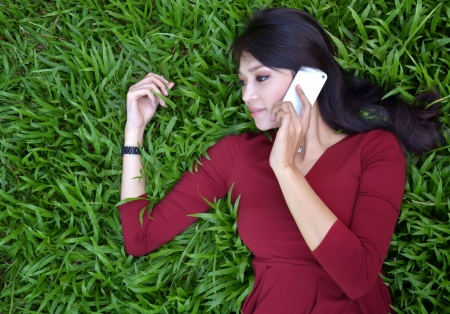 call of nature: pretty woman making a phone call in the garden