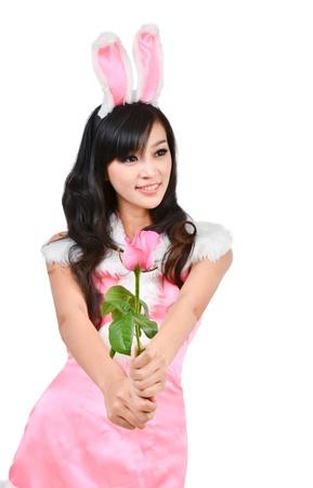 Sexy bunny girl hold pink rose Isolated on white background photo