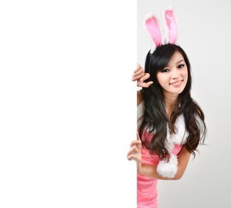 asian bunny: Sexy bunny girl hold white board Isolated on gray background