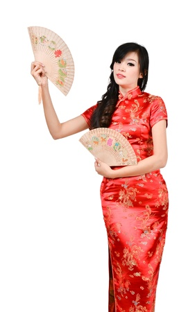 chinese dress: pretty women with Chinese traditional dress Cheongsam and hole Chinese Fan on white background