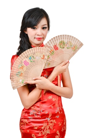 pretty women with Chinese traditional dress Cheongsam and hole Chinese Fan on white background photo
