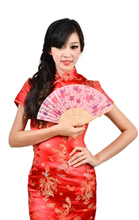 pretty women with Chinese traditional dress Cheongsam and hole Chinese Fan on white background