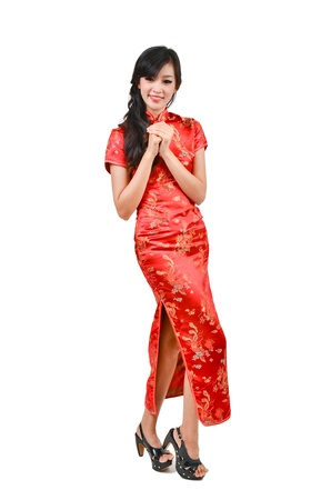 chinese dress: pretty girl with cheongsam wishing you a happy Chinese new year on white background Stock Photo