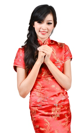pretty girl with cheongsam wishing you a happy Chinese new year onwhite background photo