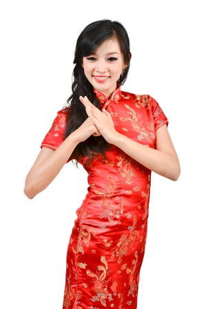pretty girl with cheongsam wishing you a happy Chinese new year on white background Stock Photo - 17278879