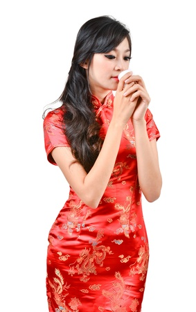 pretty women with Chinese traditional dress Cheongsam and drinking tea on white background photo