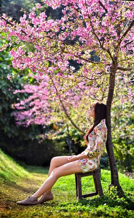 beautiful sad young woman in the garden photo