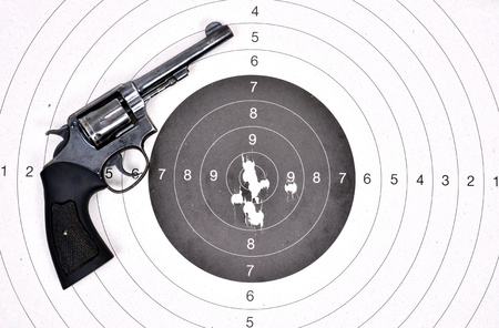 old revolver gun on the target photo