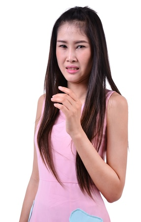 unpleasant: pretty  woman with disgusted expression on white background Stock Photo