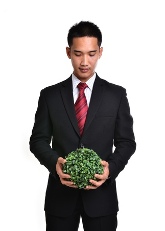 bussiness man: bussiness man with future eco - green energy concept isolated