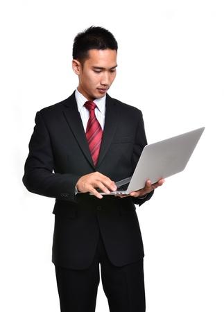 흰색 배경에 고립 된 노트북 비즈니스 남자