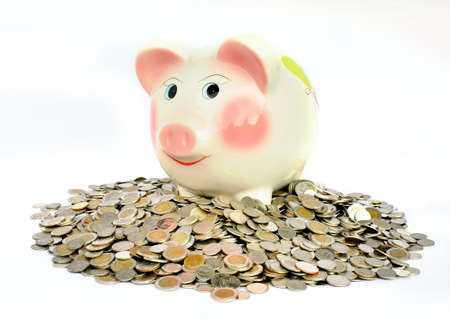 mounds: Pink piggy bank with many coins