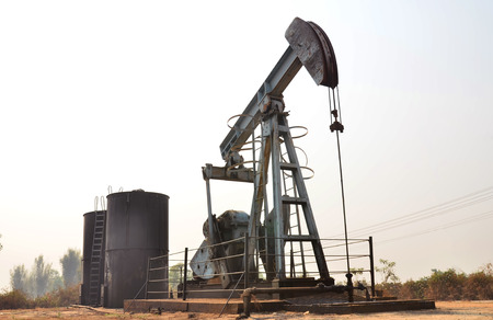 jack pump: old pumpjack pumping crude oil from oil well