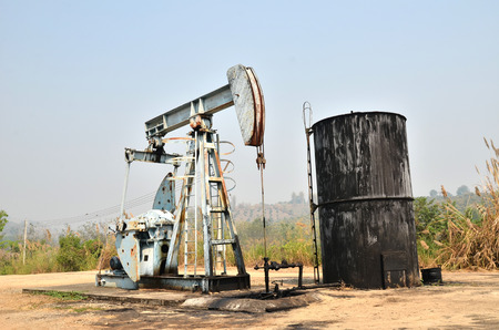 old pumpjack pumping crude oil from oil well