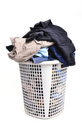 unwashed cloth in the basket on white background photo