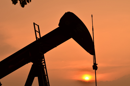 dug well: pumpjack pumping crude oil from oil well