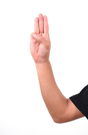 dictator: man show 3 finger for anti dictator in thailand Stock Photo