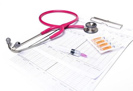 ampule syringe and stethoscope on white table photo