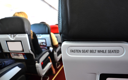 airplane seat with fasten seat belt while seated text photo