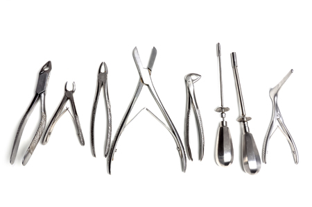 Surgical instruments isolated on white background photo