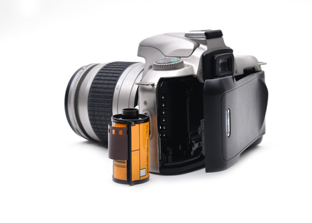 photographic camera: camera with 35 mm film on white background