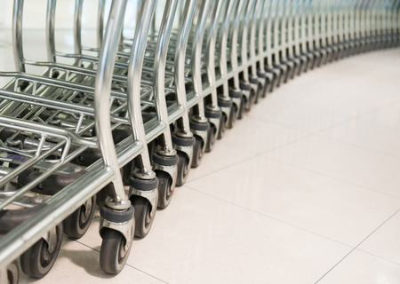shopping trolleys: row of shopping cart at a supermarket