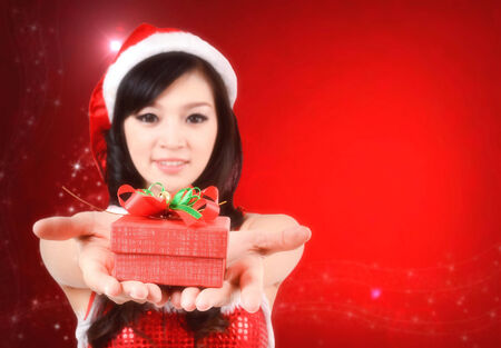 pretty women in santa outfit and christmas background photo