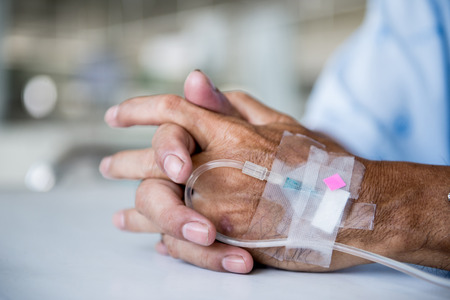 hospital patient: Patient with IV drip in a hospital