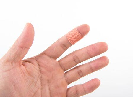 adhesive bandage: adhesive bandage on the injury finger