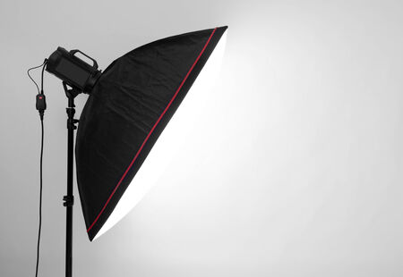 halogen lighting: empty studio gray background and flash light