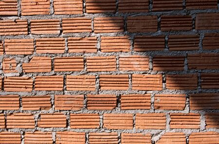 background textured of brick wall with shadow photo