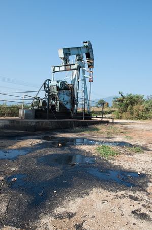 horsehead pump: pump jack with crude oil contaminatate to environment