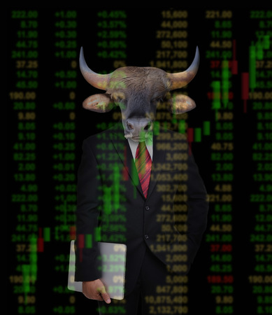 business man with bull head in tock investment concept photo
