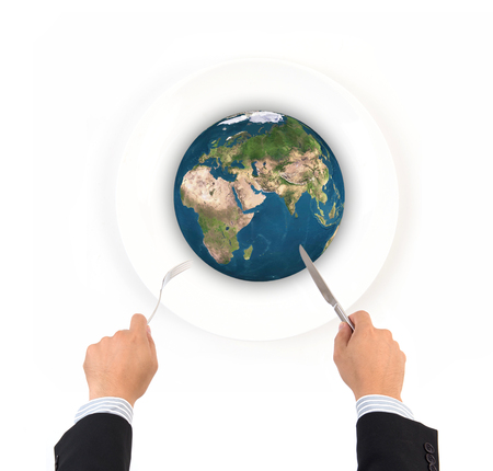 feed the poor: World globe ball with fork and knife isolated on white background, Elements of this image furnished by NASA