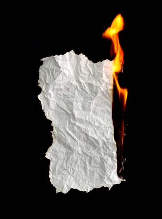 burned paper: white crumpled  paper burning on black background