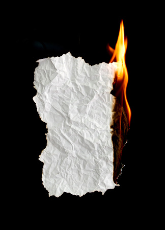 white crumpled  paper burning on black background