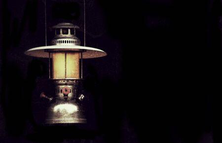storm background: old storm lantern in the dark background vintage style