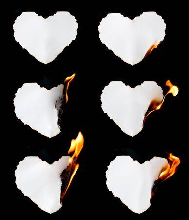 burn: heart shape paper burning on black background