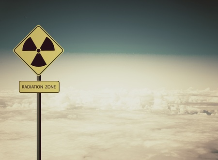 radiation warning sign: nuclear radiation warning symbol with blue sky