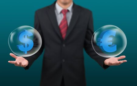dollar symbol: man show dollar and euro symbol in bubble on hand Stock Photo