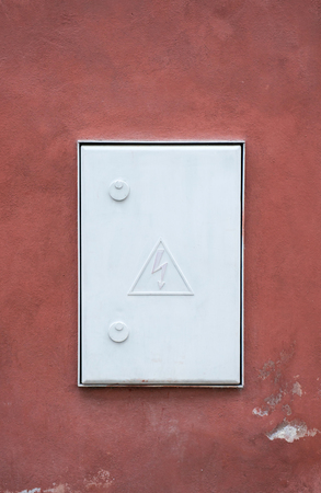 hight: hight voltage electric board on red wall