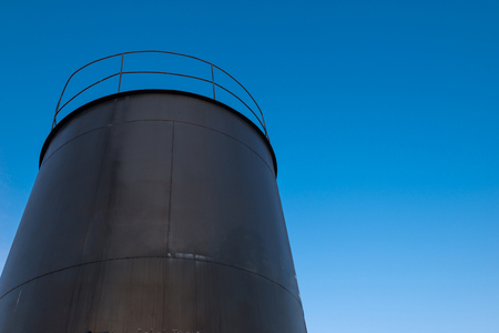 crude oil storage tank with blue sky