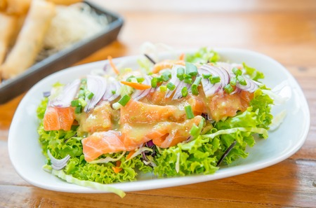 resturant: fresh salmon salad on the table