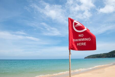 no swimming sign: No swimming danger sign at the beach Stock Photo