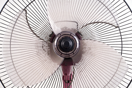 domestic life: dirty electric fan cause of allergy on white background Stock Photo